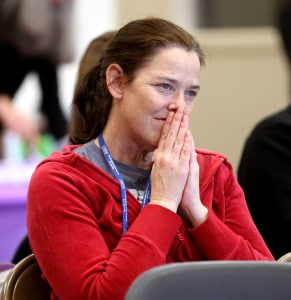 Maggie Mintken, assistant principal at Grand Island Senior High School, watches the Ombudsman Center graduation with admiration. (Independent/Andrew Carpenean)