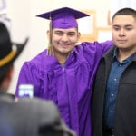 Grand Island Ombudsman Center graduate Cristian Echeverria Guzman has his picture taken with his best friend Johny Cruz concluding a commencement ceremony Friday.